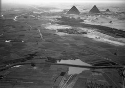 Aerial view from north of cultivated Nile valley with the pyramids in the background